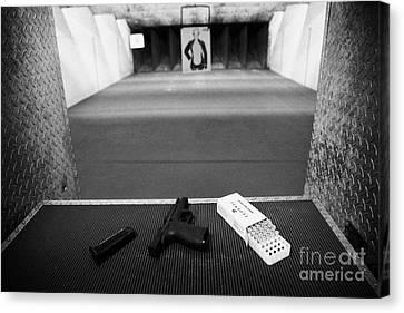 Smith And Wesson 9mm Handgun With Ammunition At A Gun Range In Florida Canvas Print by Joe Fox