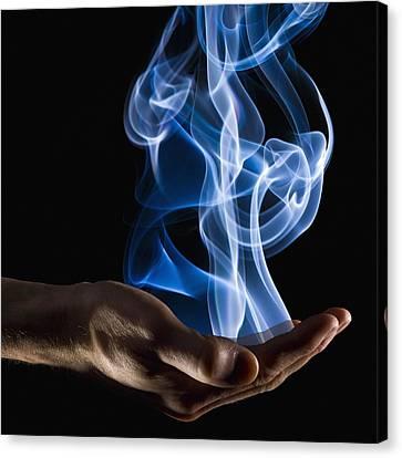 Smoke Wisps From A Hand Canvas Print by Corey Hochachka