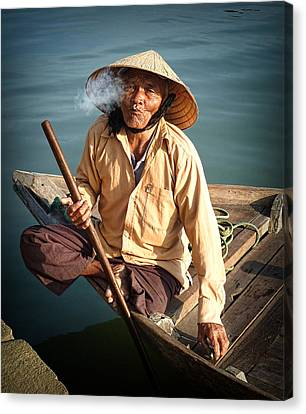 Canvas Print featuring the photograph Smoking Boat-man by Kim Andelkovic