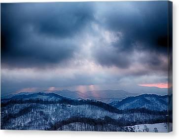 Smoky Sunset Canvas Print by John Haldane