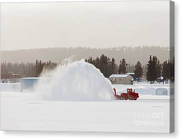Snow Blower Clearing Road In Winter Storm Blizzard Canvas Print by Stephan Pietzko