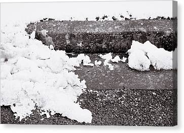 Snow By The Kerb Canvas Print