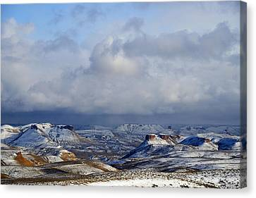 Snow Clouds Over Flaming Gorge Canvas Print by Eric Nielsen