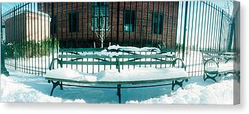Snow Covered Bench In A Park, East Canvas Print by Panoramic Images