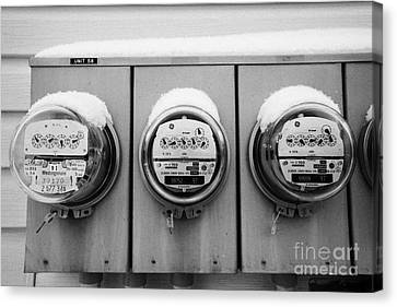 snow covered electricity meters in Saskatoon Saskatchewan Canada Canvas Print