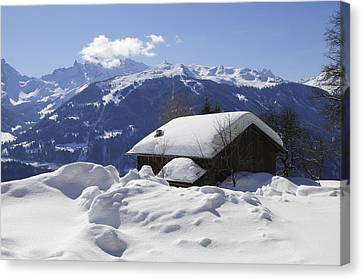 Vorarlberg Canvas Print - Snow-covered House In The Mountains In Winter by Matthias Hauser