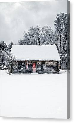 Snow Covered Log Cabin Canvas Print
