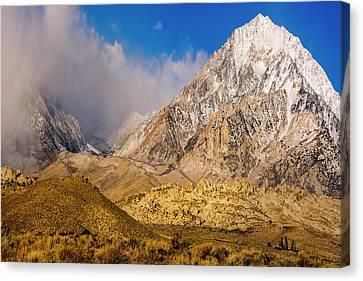 Snow Covered Peak Canvas Print by Tom Norring