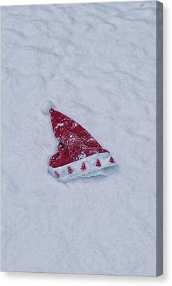 snow-covered Santa hat Canvas Print by Joana Kruse