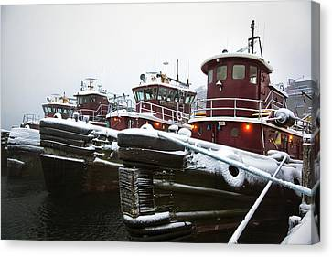 Snow Covered Tugboats Canvas Print by Eric Gendron