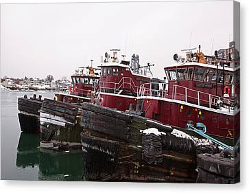Snow Covered Tugs Canvas Print by Eric Gendron