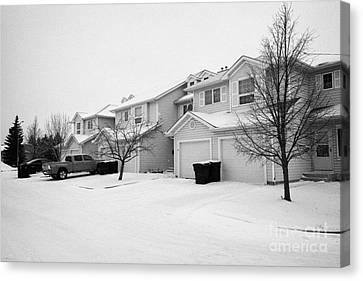 snow falling in residential street during winter Saskatoon Saskatchewan Canada Canvas Print