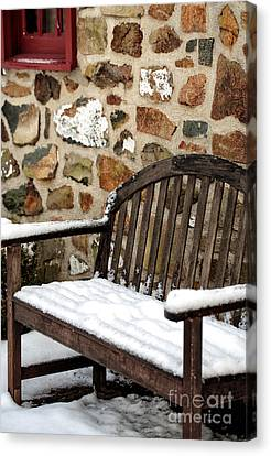 Snow On The Bench Canvas Print by John Rizzuto