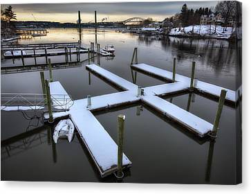 Snow On The Docks Canvas Print by Eric Gendron
