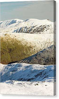 Snow On The High Street Fells Canvas Print by Ashley Cooper
