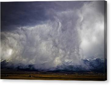 Snow On The Rockies Canvas Print by Greg Reed