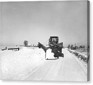 Snow Plow Clearing Roads Canvas Print by Underwood Archives