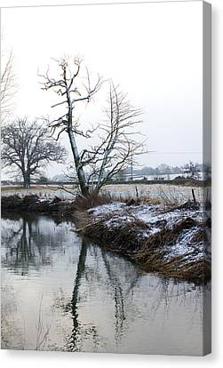 Snow Scene With River Running Through Canvas Print by Fizzy Image
