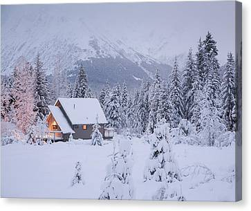 Snowcovered Home In A Wintry Meadow At Canvas Print by Jeff Schultz