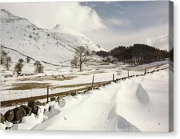 Snowdrifts Below Helvellyn Canvas Print by Ashley Cooper