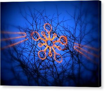 Canvas Print featuring the photograph Snowflake Christmas Lights by Aurelio Zucco