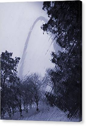 Snowing At The Arch Canvas Print by Garry McMichael