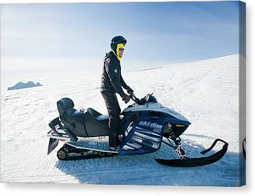 Exhilarating Canvas Print - Snowmobilers by Ashley Cooper