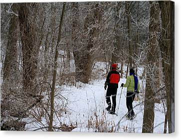 Snowshoeing In The Park Canvas Print