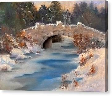 Snowy Bridge Canvas Print by Lori Ippolito