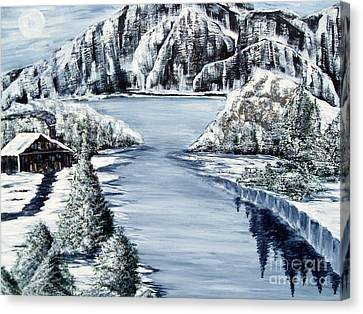 Snowy Cabin By The Lake Canvas Print