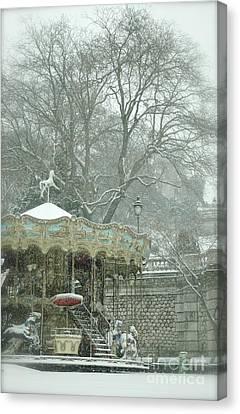 Snowy Carousel Canvas Print by Louise Fahy