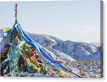 Tibetan Buddhism Canvas Print - Snowy Landscape With Prayer Flags by Sergey Orlov