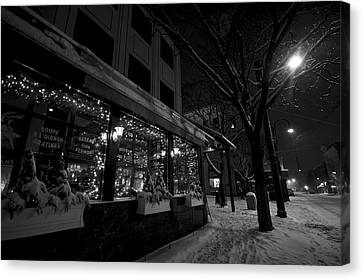 Snowy Night In Burlington Canvas Print by Mike Horvath