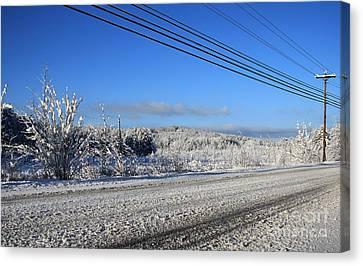 Snowy Roads Canvas Print by Michael Mooney