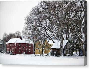 Snowy Village Canvas Print by Eric Gendron