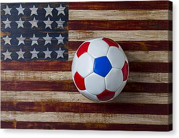 Soccer Ball On American Flag Canvas Print by Garry Gay