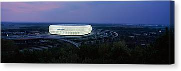 Soccer Stadium Lit Up At Nigh, Allianz Canvas Print by Panoramic Images