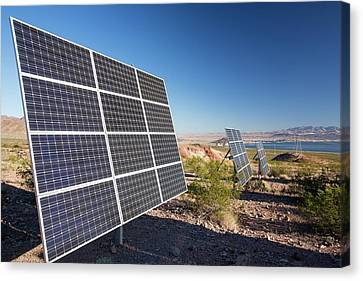 Solar Panels Next To A Church Canvas Print by Ashley Cooper