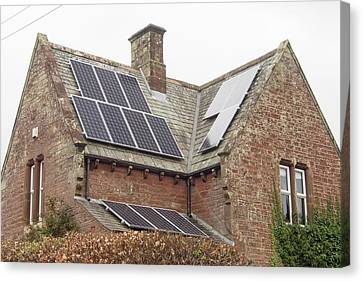 Solar Panels On A House Canvas Print by Ashley Cooper