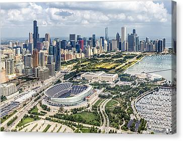 Soldier Field And Chicago Skyline Canvas Print by Adam Romanowicz