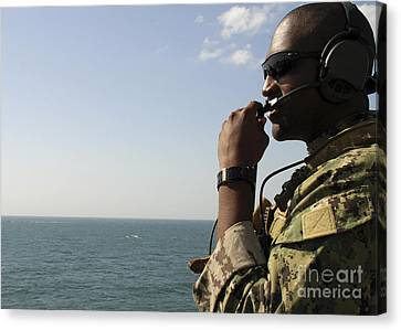 Soldier Instructs Small Boat Maneuvers Canvas Print by Stocktrek Images