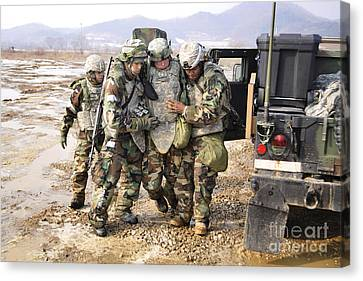 Soldiers Conduct Medical Evacuation Canvas Print by Stocktrek Images