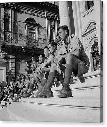 Soldiers Sitting On The Steps Canvas Print by Stocktrek Images
