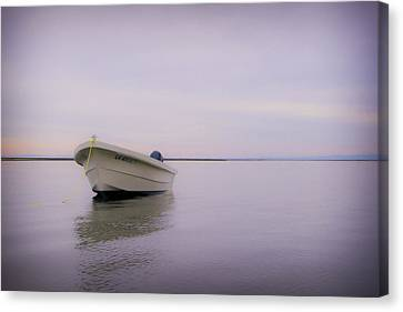 Solitary Boat Canvas Print by Adam Romanowicz