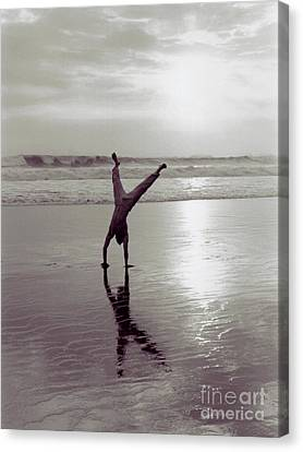Canvas Print featuring the photograph Somersalting On Bali Black Sand Beach 2 by Mukta Gupta