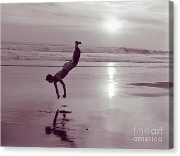 Canvas Print featuring the photograph Somersalting On Bali Black Sand Beach by Mukta Gupta