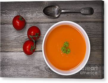 Soup On Wood Table Canvas Print by Jane Rix