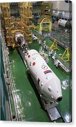 Soyuz Rocket Preparation Canvas Print by Nasa/victor Zelentsov