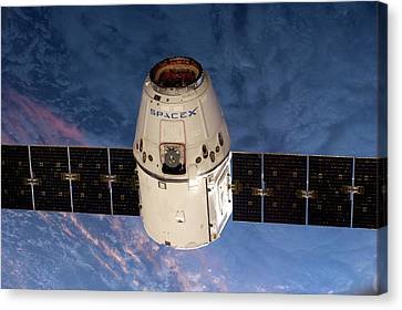 Spacex Dragon Capsule At The Iss Canvas Print by Nasa
