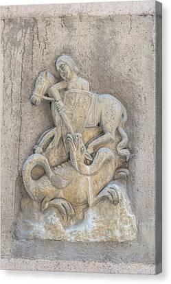 Spain, Barcelona, Relief Sculpture Of St Canvas Print by Jim Engelbrecht